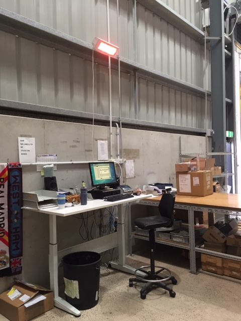 Heliosa 44 warms a workstation in a large unheated factory