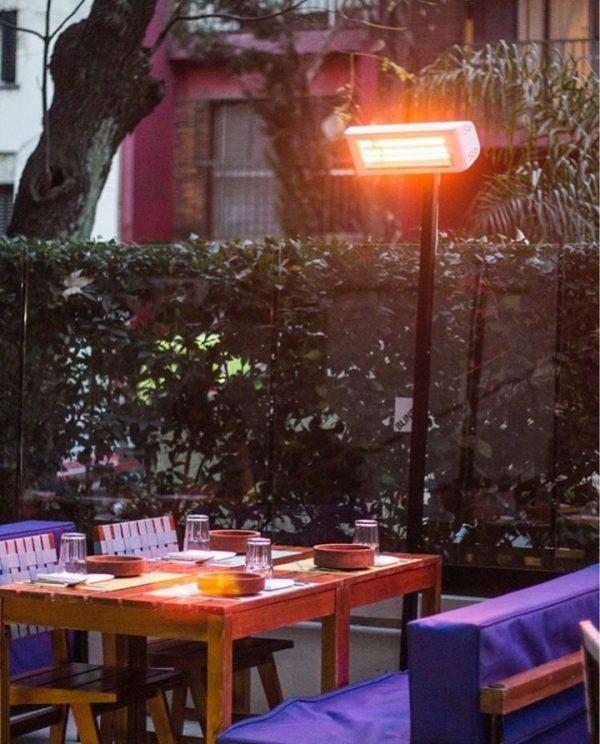 Heliosa 44 on a stand heats an outdoor restaurant table